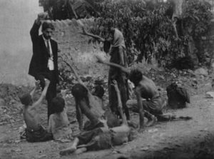 A Turkish official teases starving Armenian children with bread during the Armenian Genocide