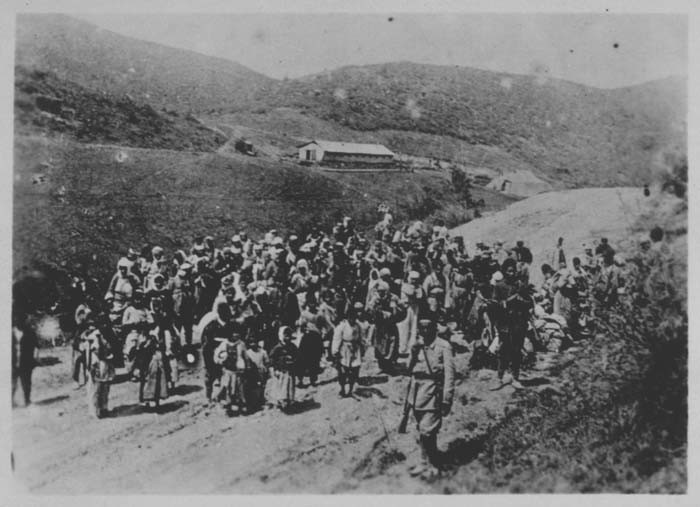 Ottoman troops guard Armenians being deported. Ottoman Empire, 1915-16