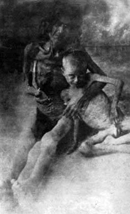 Starved Armenian woman with her son in Syrian desert, 1916