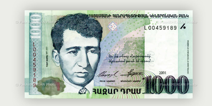 1000-dram bank note featuring Armenian writer Yeghishe Charents and a carriage with an old building in Yerevan at the background