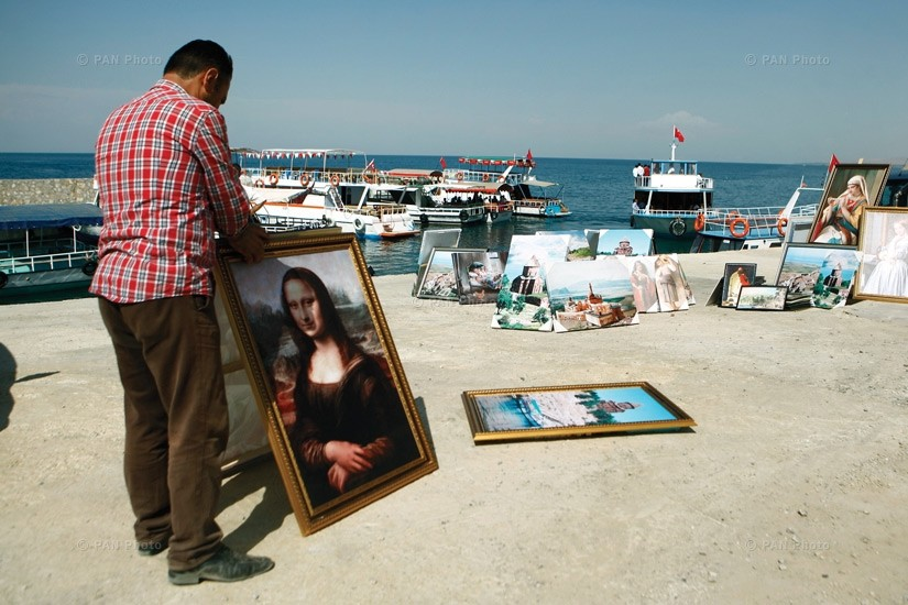 A painter selling his work on the shore of Lake Van.